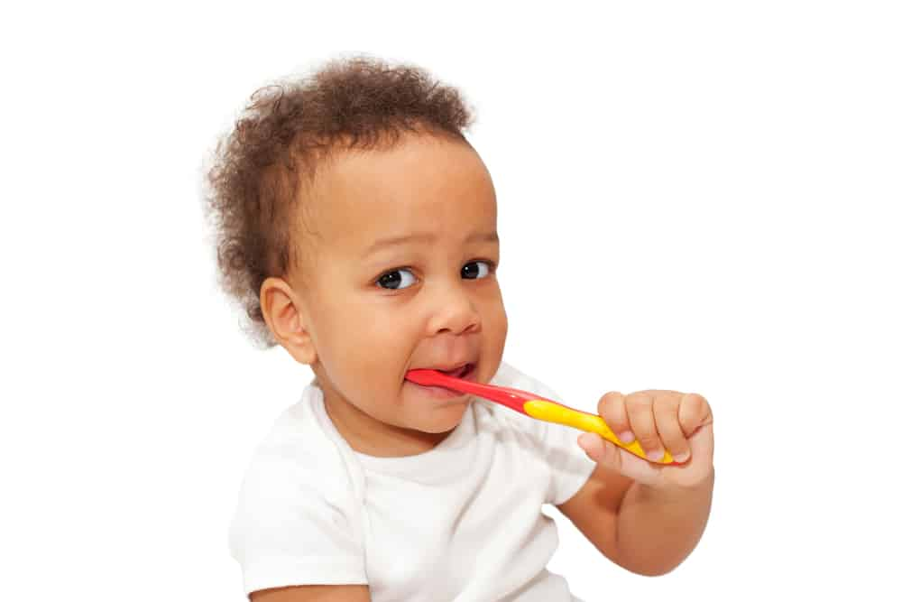 Toddler brushing their teeth
